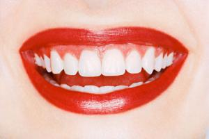 Осветление зубов лазером